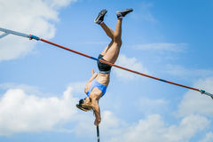 Pole vault girl Stock Photo