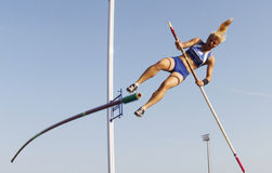 Pole vault jumper failing. An athlete fails while attempting to pole vault during a local Athletics youth competition in the Spanish island of Majorca Royalty Free Stock Photo