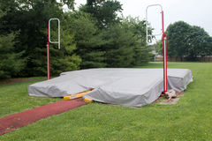 Pole vault pit coverd up. A local high school pole vault pit is coverd up with a gray tarp Royalty Free Stock Images