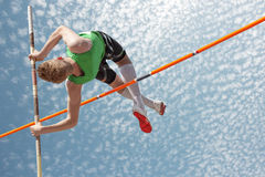 Pole vault sky. Young athletes pole vault seems to reach the sky Stock Photo