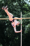 Pole vaulter. A female pole vaulter with a bacground of trees Royalty Free Stock Photography