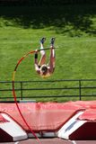 Pole Vaulter. Woman pole vaulter in mid air Royalty Free Stock Photography
