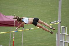 Pole Vaulter. Clearing the bar Stock Image