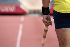 Pole vaulter prepares for jump Stock Photo