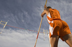 Pole Vaulter Preparing For A Jump Royalty Free Stock Photo