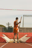 Pole Vaulter Standing With Pole Royalty Free Stock Photo