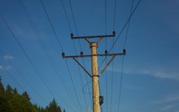 Pole with wires, power and energy concept. Clear blue sky royalty free stock photos