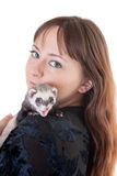 Polecat on a shoulder. Portrait of the woman with a domestic polecat stock images