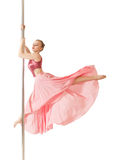 Poledance woman posing in beautiful pink dress Stock Photography