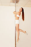 Poledancer girl Royalty Free Stock Photography
