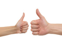 Polegar acima dos homens e das mãos das mulheres Imagem de Stock Royalty Free