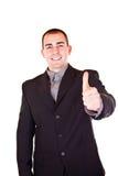 Polegar bem sucedido da terra arrendada do homem de negócios acima Imagens de Stock Royalty Free