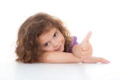 Polegar da criança acima Imagens de Stock