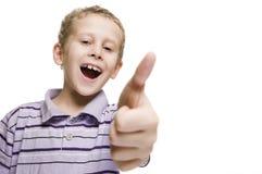 Polegar da mostra uma do menino acima do divertimento Fotos de Stock Royalty Free