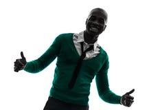 Polegar de sorriso do homem negro africano acima da silhueta Foto de Stock Royalty Free