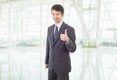 Polegar do homem de negócios acima Foto de Stock