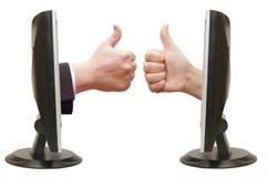 Polegares acima da mão do monitor Imagem de Stock
