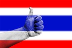 Polegares acima do sinal na bandeira de Tailândia Imagem de Stock