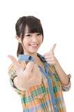 Polegares asiáticos da jovem mulher acima Fotografia de Stock Royalty Free