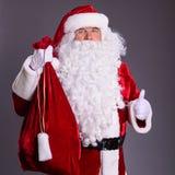 Polegares de Papai Noel acima Fotos de Stock