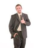 Polegares do homem de negócios acima Imagens de Stock Royalty Free