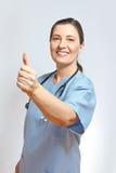 Polegares envelhecidos meio da enfermeira acima Imagem de Stock Royalty Free