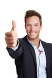 Polegares felizes da terra arrendada do homem de negócio Foto de Stock Royalty Free