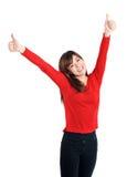 Polegares felizes das mãos da menina dois acima no vermelho Fotos de Stock Royalty Free