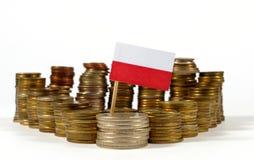 Polen flagga med bunten av pengarmynt Royaltyfria Bilder