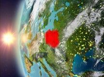 Polen tijdens zonsondergang van ruimte Stock Foto's
