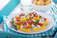 Polenta appetizers with ricotta and bacon Royalty Free Stock Photo