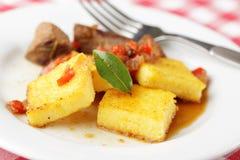 Polenta avec de la viande Photos libres de droits