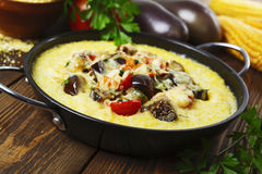 Polenta baked with vegetables and cheese Stock Images