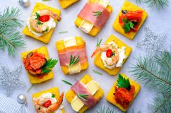 Polenta Bites with Different Toppings, Variety of Polenta Appetizers, Delicious Snack stock photos