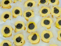 Polenta circles made with cornmeal and basil pesto and cream ins Stock Photos