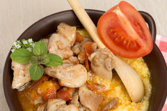 Polenta - corn porridge with stewed chicken in oil Stock Photos