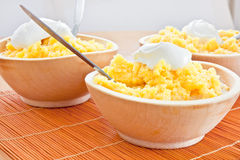 Polenta corn traditional food wooden dish Royalty Free Stock Image
