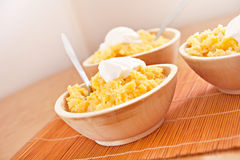 Polenta corn traditional food in wooden dish Royalty Free Stock Photos