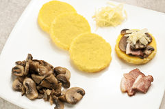 Polenta: cornmeal with mushrooms and bacon Stock Image