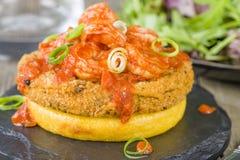 Polenta, Fishcake & Spicy Prawns. Polenta, Fishcake & Spicy Prawns - Crispy polenta round topped with chorizo fishcake and prawns in tomato and chili sauce Royalty Free Stock Photos
