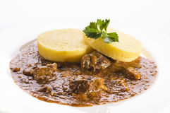 Polenta with goulash Royalty Free Stock Photo