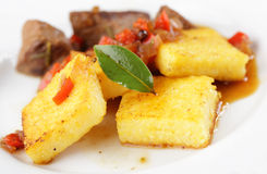 Polenta with meat Stock Image
