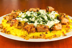 Polenta with meat and homemade cheese on the plate Royalty Free Stock Photos