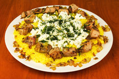 Polenta with meat and homemade cheese on the plate Royalty Free Stock Photo