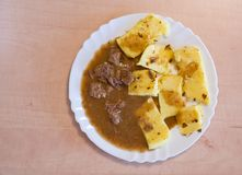 Polenta with meat souce Royalty Free Stock Photo