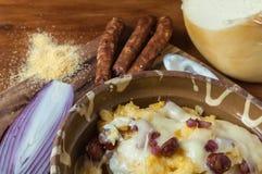 Polenta med ost och korvar Royaltyfria Bilder