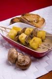 Polenta with mushrooms brochettes Royalty Free Stock Photography