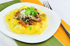 Polenta with mushrooms, caramelized onions and herbs Stock Image