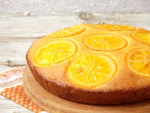 Polenta and orange butter cake. оn a wooden table royalty free stock photos