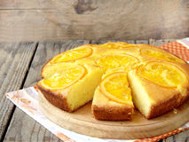Polenta and orange butter cake. оn a wooden table royalty free stock photography